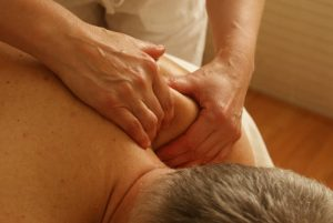male patient getting a neck massage
