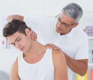 chiropractor stretching male patients neck
