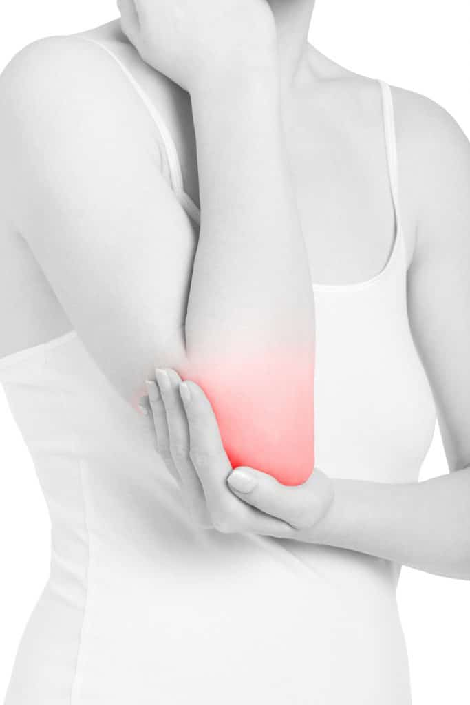 woman holding her elbow due to inflammation pain
