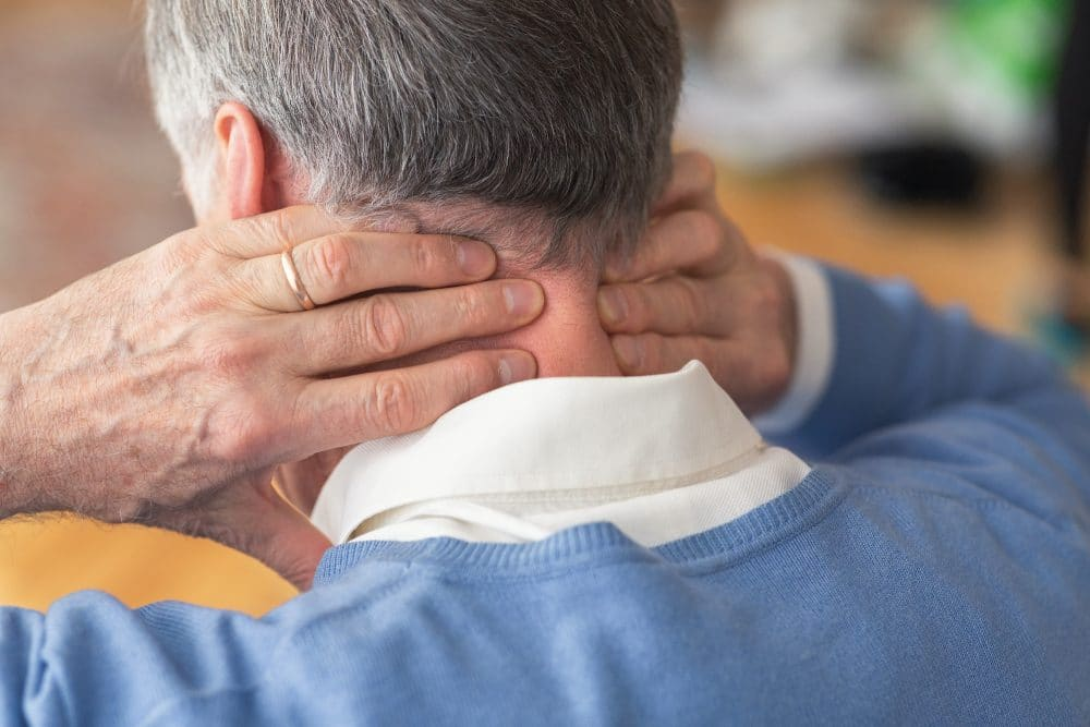 elderly man having neck pain