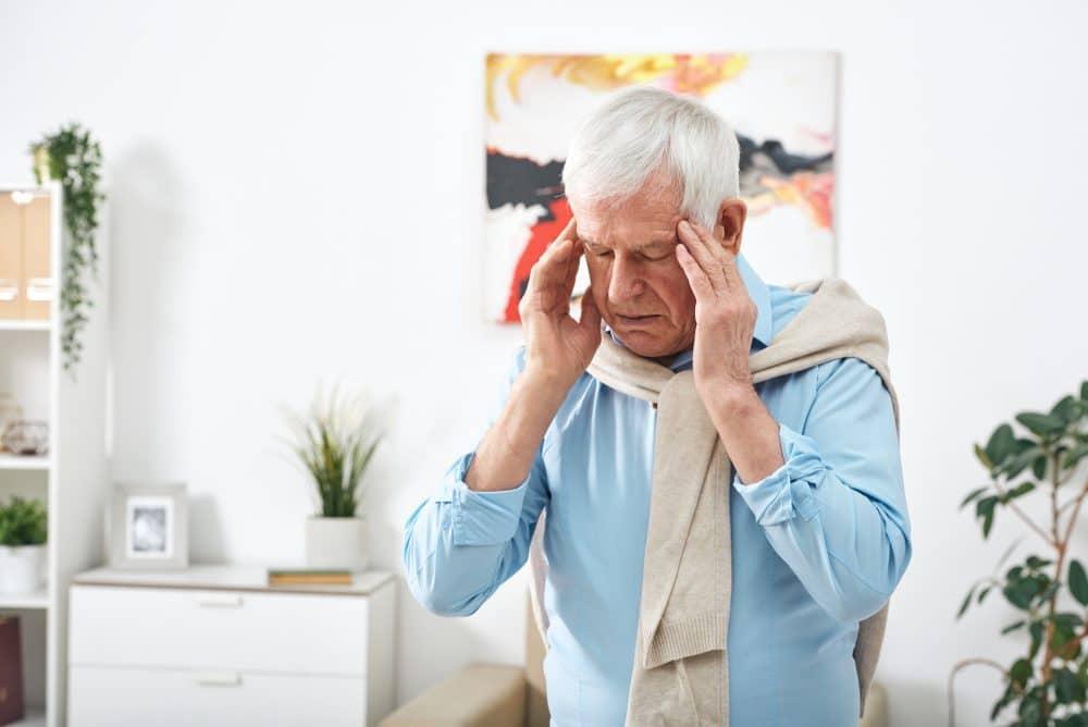 elderly man having a headache