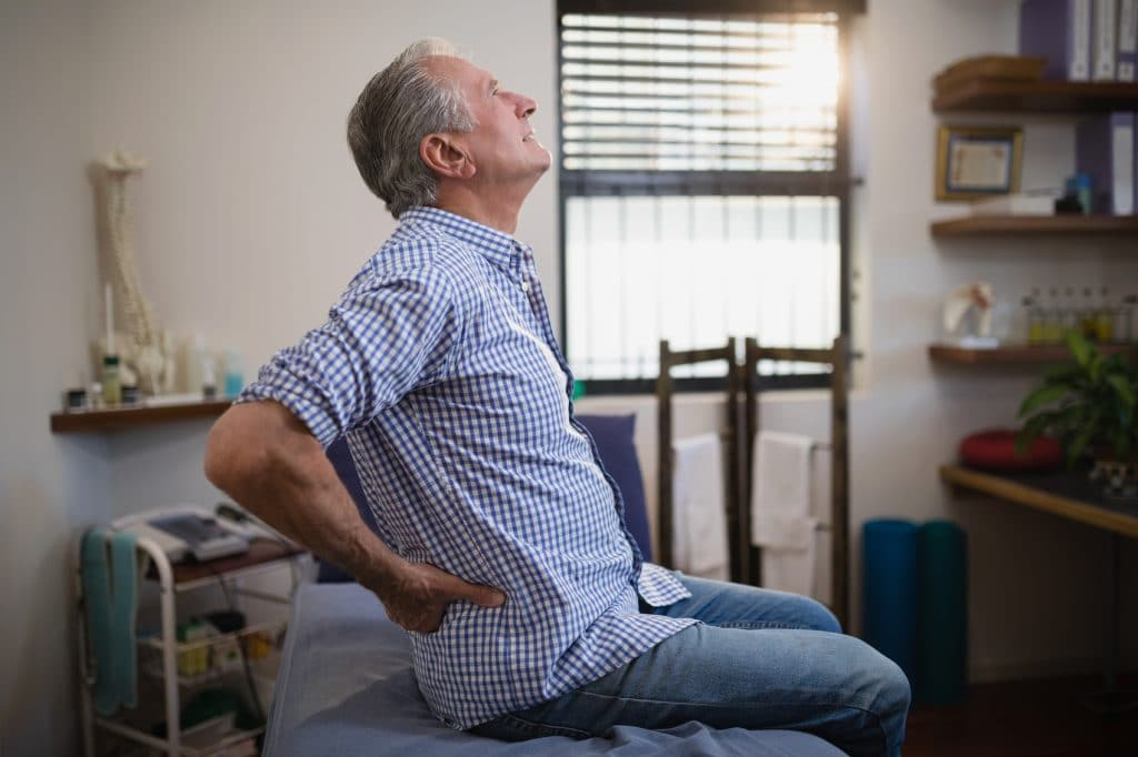 Male having a lower back pain