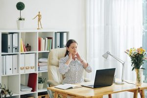 business woman suffering from tech neck