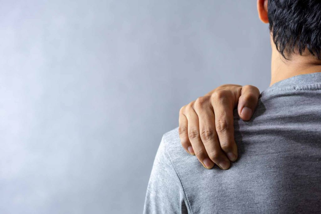 Man suffering from frozen shoulder.