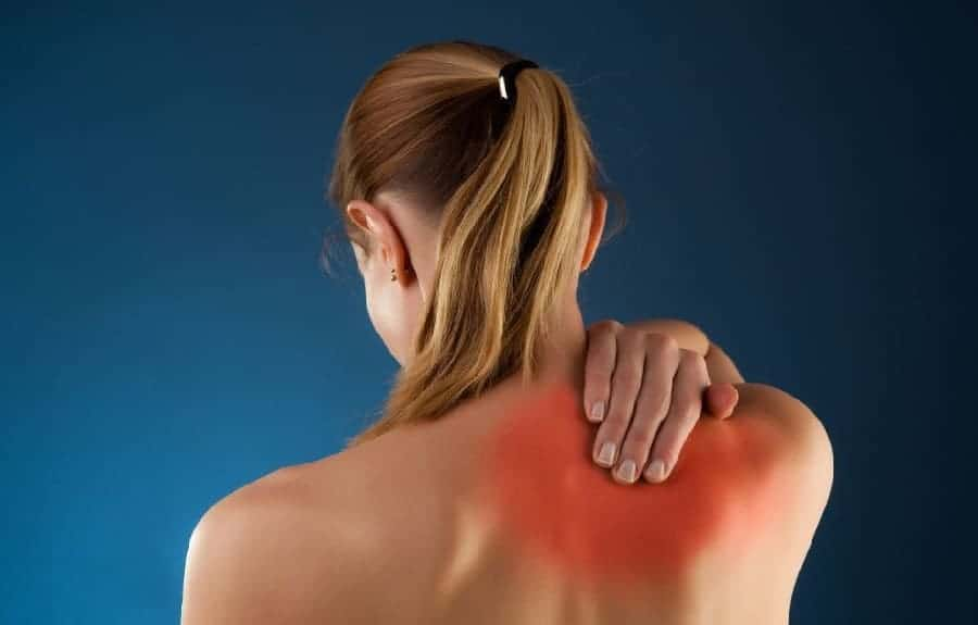 Woman touching his back due to pain from pinched nerve.